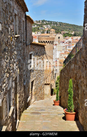 Picturesque narrow medieval street in Tossa de Mar, Spain, on May 24, 2016 - Stock Photo