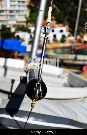 closeup of some sailing boats stranded in a beach in a Mediterranean village - Stock Photo