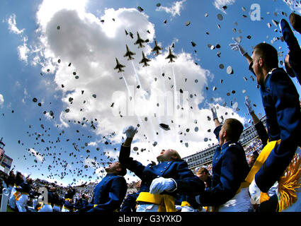 U.S. Air Force Academy graduates throw their hats in the air. - Stock Photo