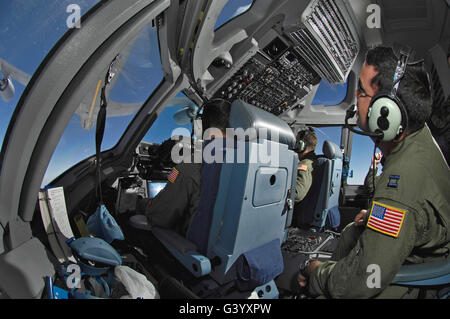 C-17 Globemaster III aircrew members practice aerial refueling. - Stock Photo
