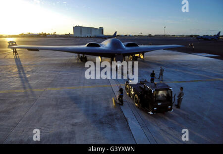 A B-2 Spirit stealth bomber is towed to a parking spot. - Stock Photo