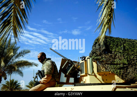U.S. Air Force Airman sits on his tactical vehicle. - Stock Photo