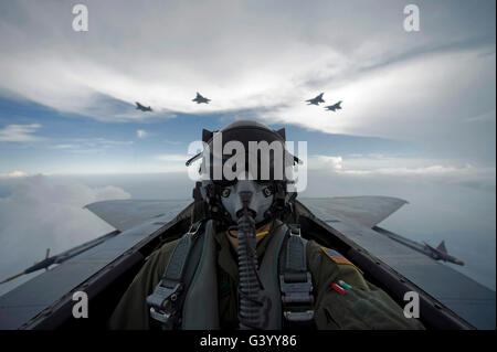 U.S. Air Force pilot takes a self portrait during a sortie with F-15 Eagles and F-22 Raptors. - Stock Photo
