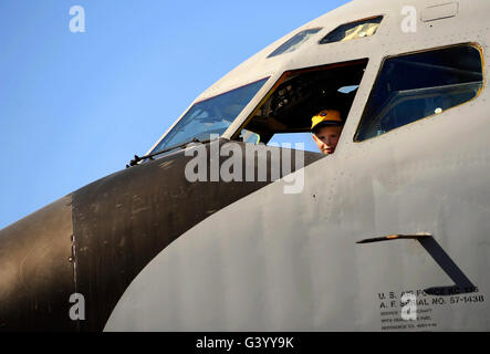 A boy checks out the cockpit of a KC-135 Stratotanker. - Stock Photo
