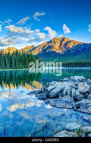 Golden sunrise over Pyramid Mountain at Pyramid Lake in Jasper National Park, Alberta, Canada. - Stock Photo