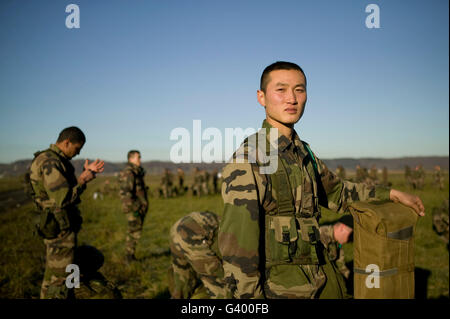 Member of the French Foreign Legion Wang from China waits in line during multi-force exercise held at Tarbes airport - Stock Photo