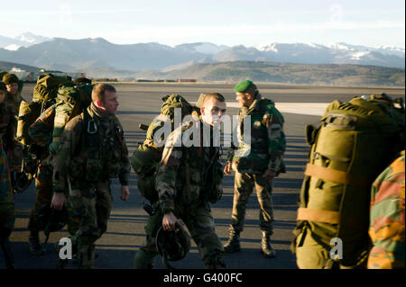 Members of the French Foreign Legion and soldiers from Belgium (with yellow markings in uniforms) walk across the - Stock Photo