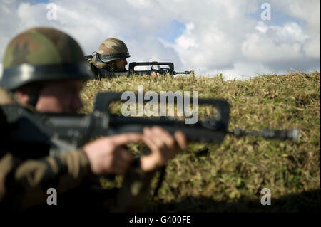 Members of the French Foreign Legion hold their positions during a full scale multi-force exercise held at the airport - Stock Photo