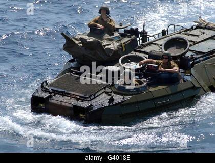 An Amphibious Assault Vehicle approaches an amphibious transport dock ship. - Stock Photo