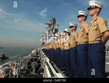Marines man the rails aboard the amphibious assault ship USS Iwo Jima. - Stock Photo