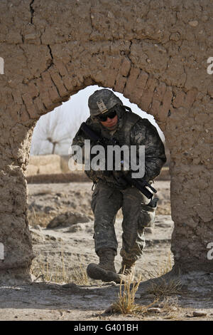 U.S. Army soldier provides security during a dismounted patrol in Afghanistan. - Stock Photo