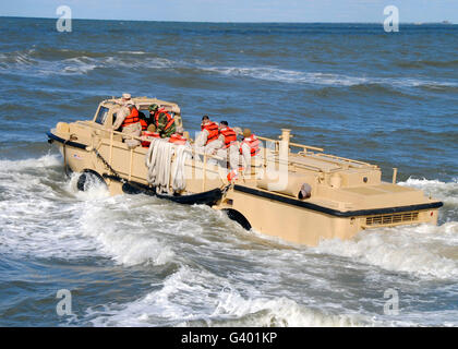 A Lighter Amphibious Resupply Cargo vehicle returns to sea after unloading supplies. - Stock Photo