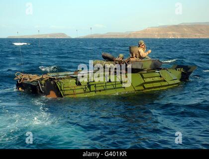 U.S. Marines driving an amphibious assault vehicle. - Stock Photo