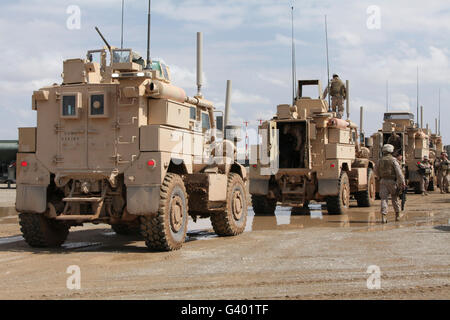 A convoy of MRAP vehicles near Camp Leatherneck, Afghanistan. - Stock Photo