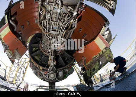 U.S. Air Force technician hydraulically opens the engine cowlings of a KC-10 Extender. - Stock Photo