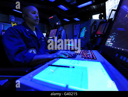 Air Traffic Controller stands watch aboard USS George H.W. Bush. - Stock Photo