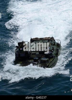 An amphibious assault vehicle approaches the well deck of USS Iwo Jima. - Stock Photo