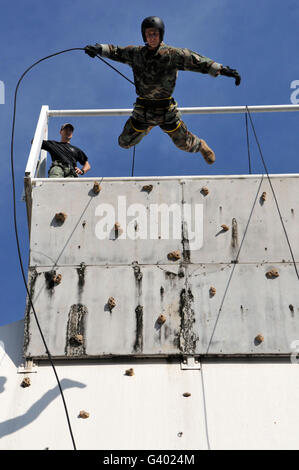 Soldier rappels off a tower while training during Exercise Talisman Sabre 2011. - Stock Photo