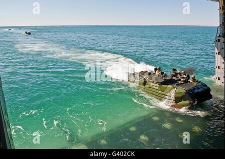 Amphibious assault vehicles enter the well deck of USS New York. - Stock Photo