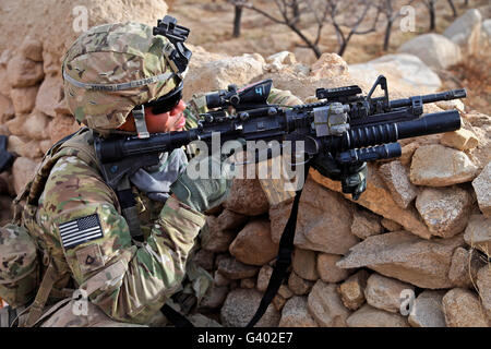 U.S. Army soldier provides security  in Afghanistan. - Stock Photo