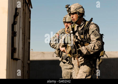 U.S. Army soldiers search a site during an air assault operation. - Stock Photo