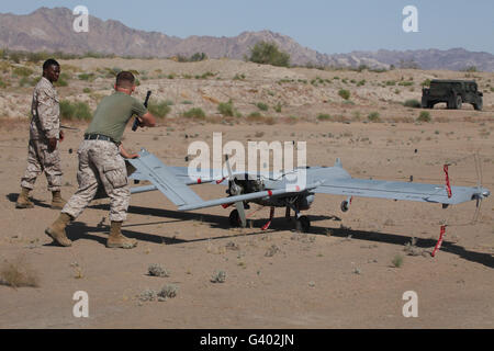 U.S. Marines recover an RQ-7B Shadow unmanned aerial vehicle. Stock Photo