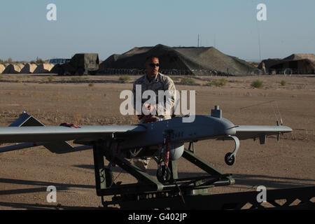 A U.S. Marine prepares to launch an RQ-7B Shadow. Stock Photo