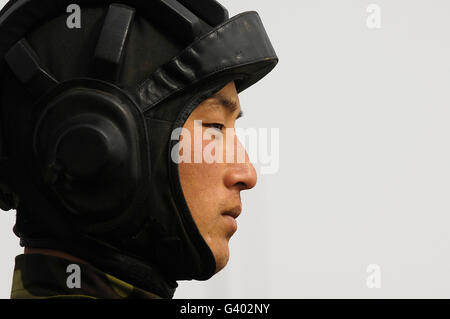 A Chinese tanker soldier with the People's Liberation Army. - Stock Photo