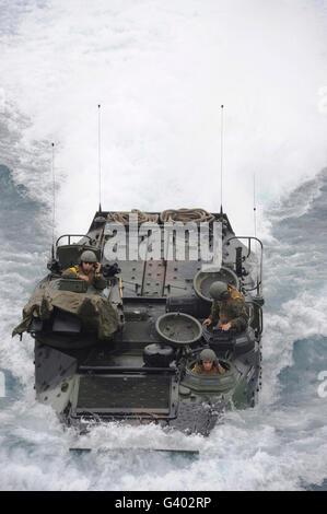 An amphibious assault vehicle approaches the well deck of USS Makin Island. - Stock Photo