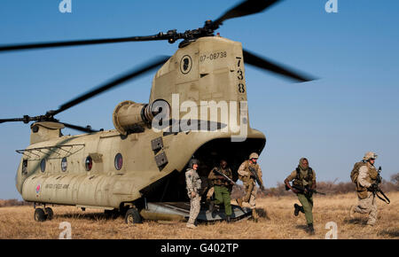 U.S. Marines exit a Hawaii Army National Guard CH-47F Chinook helicopter. Stock Photo