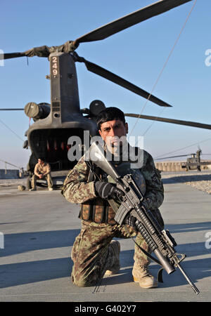 An Afghan National Army soldier provides security. - Stock Photo