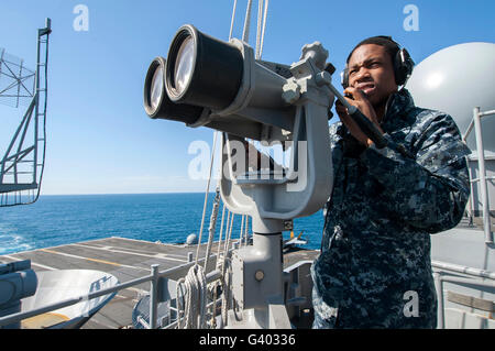 Seaman stands lookout aboard the aircraft carrier USS Harry S. Truman. - Stock Photo