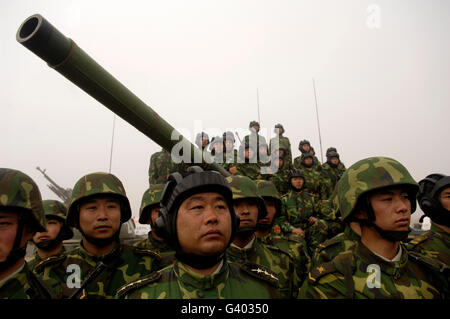 Chinese tanker soldiers with the People's Liberation Army. - Stock Photo