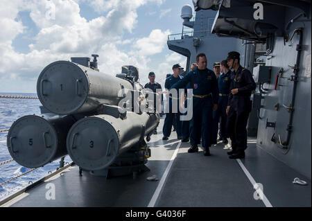 Sailors aboard the Japan Maritime Self Defense Force JS Murasame. - Stock Photo