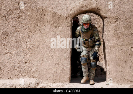 A Georgian Army soldier exits a compound in Afghanistan. - Stock Photo