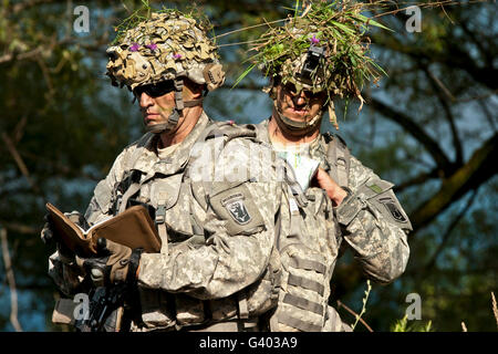 U.S. Army National Guards prepare to conduct a movement. - Stock Photo