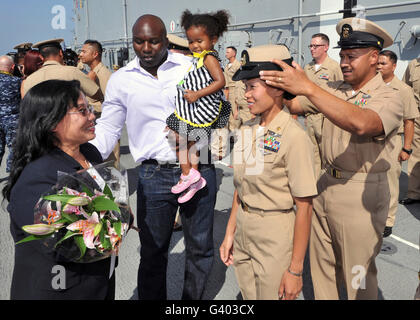 Family members gather around chief petty officer ashe receives her combination cover. - Stock Photo