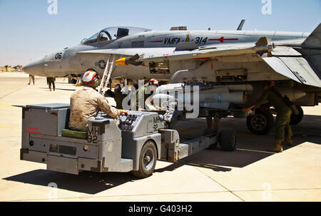 A U.S. Marine Corps F-18 Hornet is loaded with simulated weapons. Stock Photo