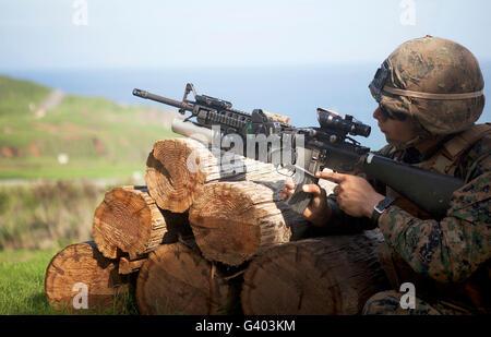 A rifleman shoots an M203 grenade launcher. - Stock Photo