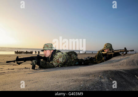 Japan Ground Self-Defense Force soldiers provide security. - Stock Photo