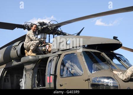 U.S. Army pilot conducts pre-flight checks on a UH-60 Black Hawk. - Stock Photo