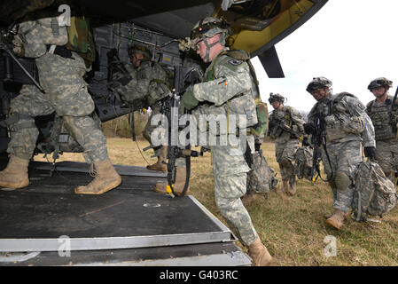 U.S. Army paratroopers board a CH-47 Chinook. - Stock Photo