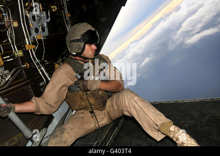 U.S. Marine provides aerial security from a MV-22 Osprey. Stock Photo