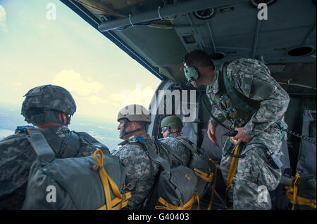 National Guard Special Forces await their turn to jump from a UH-60 Blackhawk. - Stock Photo