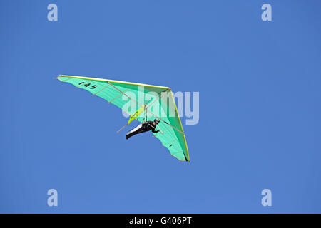 Hang glider flying over Dune of Pyla Southern France - Stock Photo