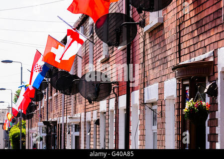 BELFAST, NORTHERN IRELAND. 03 JUN 2016 - Residents in Iris Street, Belfast decorate their homes with flags from - Stock Photo
