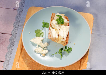 Fresh healthy breakfast, a slice of soda bread with butter and cottage cheese - Stock Photo