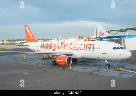 Easyjet Airbus A320 aircraft at gate, North Terminal, London Gatwick Airport, Crawley, West Sussex, England, United - Stock Photo