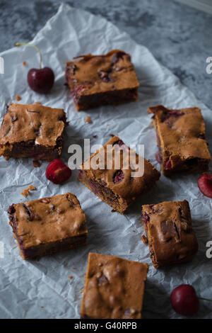 Cherries and chocolate blondies - Stock Photo