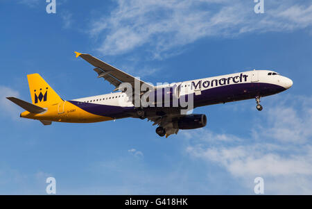 A Monarch Airlines Airbus A321-231 approaching to El Prat Airport in Barcelona, Spain. - Stock Photo